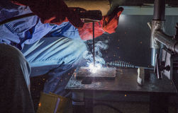 Worker use weld steel at factory Royalty Free Stock Photo