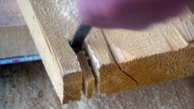 A worker uses a chisel to work with wood Board.  stock video footage