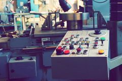 The control panel of the machine with cnc for processing material at the machine-building enterprise. stock image