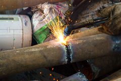 A worker uses a oxygen acetylene cutting Stock Image