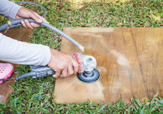Worker using angle grinder to grinding on sandstone Royalty Free Stock Images