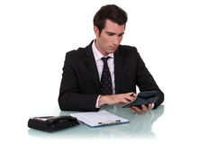 Worker using calculator Royalty Free Stock Images