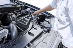 Worker using cloth to clean car machine Royalty Free Stock Photo