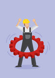 Worker Using Cogwheel as Hula Hoop Stock Photo