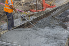 Worker using concrete vibrator Royalty Free Stock Photography