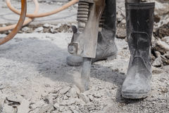 Worker using construction drilling cement on the ground Royalty Free Stock Photography