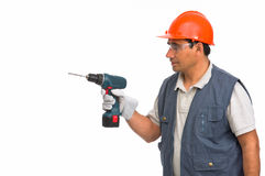 Worker using cordless electric drill. Isolated worker using cordless electric drill Royalty Free Stock Images