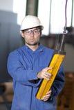 Worker using a crane Stock Photos