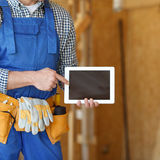 Worker using digital tablet Royalty Free Stock Photos