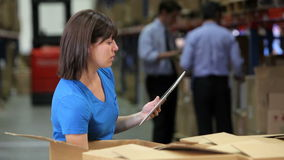 Worker Using Digital Tablet To Check Boxes stock video footage