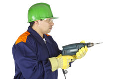 Worker using a drill Stock Photos