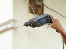 Worker using drill. To attach panel to wall Stock Photos