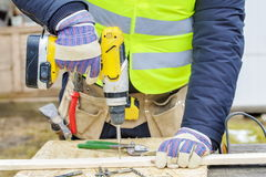 Worker using drill. In winter day Royalty Free Stock Photos