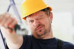 Worker using electric drill portrait Stock Photo