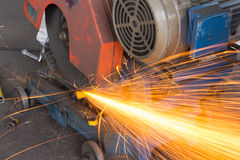 Worker using electric grinder Royalty Free Stock Images