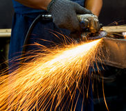 Worker using electric grinder Stock Images