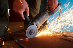 A worker using grinder cut metal. A worker using a grinder cut metal Royalty Free Stock Photos