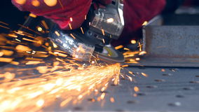 Worker using grinder. Lots of sparks. Grinding metal with a grinder. stock footage