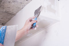 Worker using gypsum plaster Stock Photo