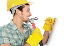 Worker using hammer Royalty Free Stock Images