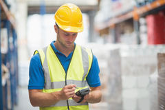 Worker using hand held computer. In warehouse Stock Photos
