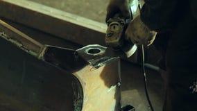 Worker using industrial grinder stock video footage