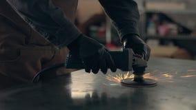 Worker using industrial grinder stock footage