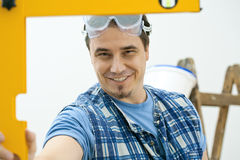 Worker using level tool Stock Photos