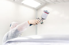 Worker using a paint spray gun Royalty Free Stock Image