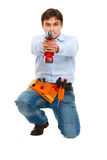 Worker using pointing drill as gun in camera. Construction worker using pointing drill as a gun in camera Stock Photo