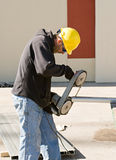 Worker Using Porta-Band Saw Royalty Free Stock Photography