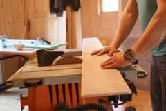 Worker using professional circular saw Royalty Free Stock Images