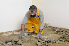Free Worker Using Putty Knife For Cleaning Floor Stock Photo - 48497650