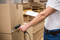 Worker using scanner in warehouse Royalty Free Stock Photos