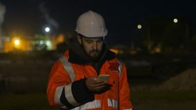 Worker using smartphone in the twilight. Night shift concept 4k. Worker using smartphone in the twilight. Night shift concept stock video footage