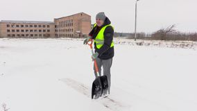 Worker using snow shovel and take break stock footage