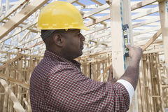 Worker Using Spirit Level At Site. Male worker using spirit level at construction site Stock Image