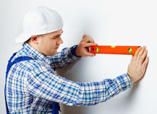 Worker using spirit level Royalty Free Stock Photo