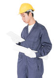 Worker using a tablet and holding blueprint on white Stock Photography