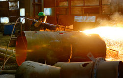 Worker using torch cutter Royalty Free Stock Images