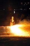 Worker using torch cutter to cut through metal Stock Photos
