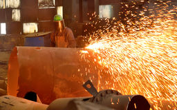 Worker using torch cutter Stock Image