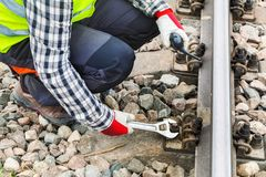 Worker using wrench on railway Stock Photo
