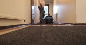 Worker vacuum cleaner carpets in the building.  stock video footage