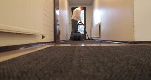 Worker vacuum cleaner carpets in the building.  stock footage