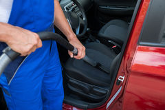 Worker Vacuuming Car With Vacuum Cleaner Royalty Free Stock Photos