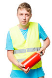 Worker in a vest with a fire extinguisher in hands Stock Photos