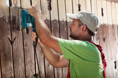 Worker with vibrating sander Stock Photos
