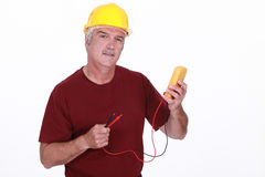 Worker with a voltmeter Royalty Free Stock Image