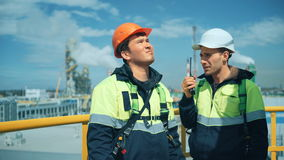 Worker with walkie talkie on industrial plant stock footage